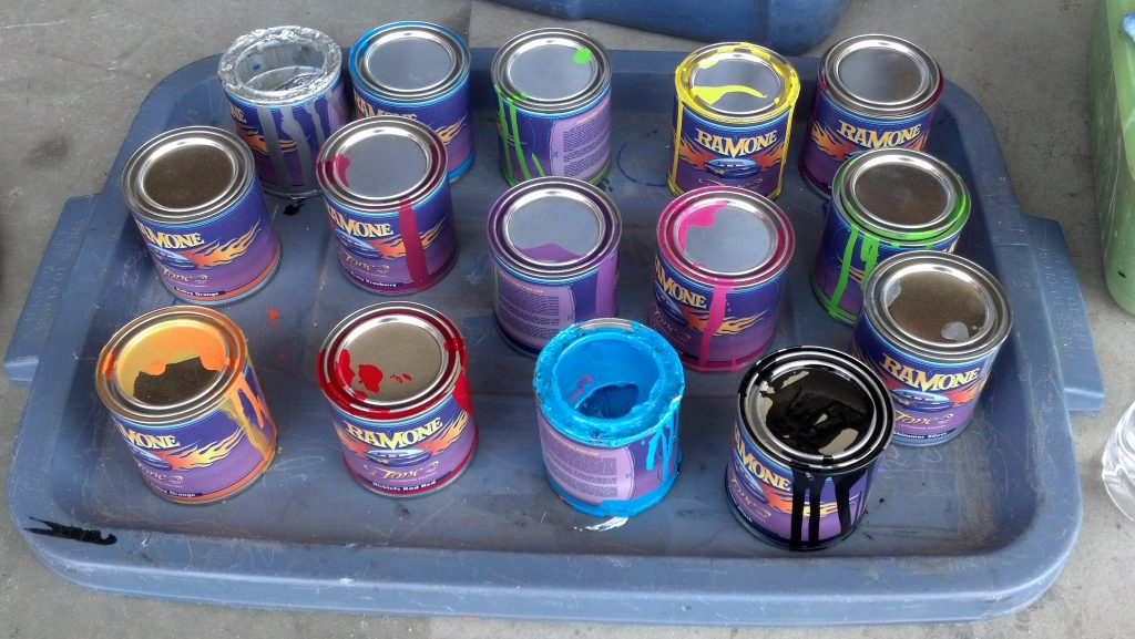 cars land paint cans