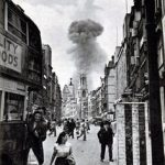An exploding V-1 is in the background of this shot taken from the streets of London