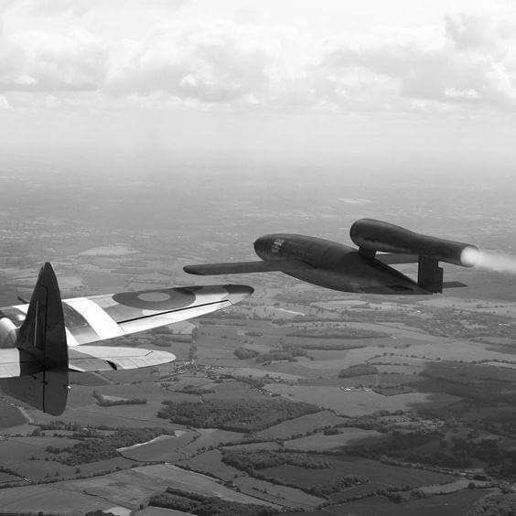 An RAF aircraft moves into position to roll the V-1 off of it's course