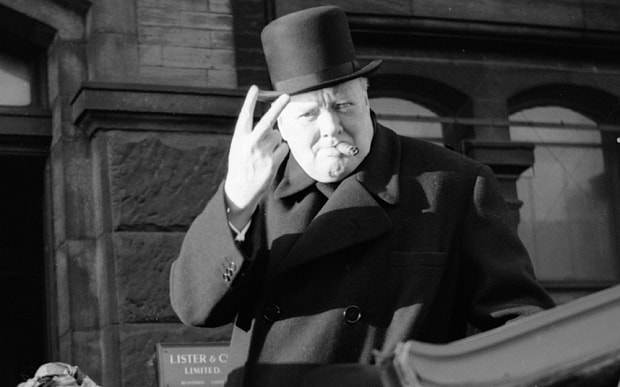 Winston Churchill flashes the victory sign, then learns that this direction means something quite different.