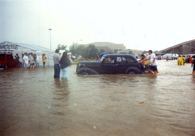 A 1938 Chevrolet Sedan gets pushed to higher ground at the 1992 NSRA Street Rod Nationals