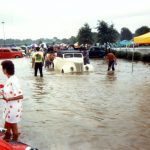 A car gets pushed to higher ground during flash flooding at the 1992 NSRA Street Rod Nationals