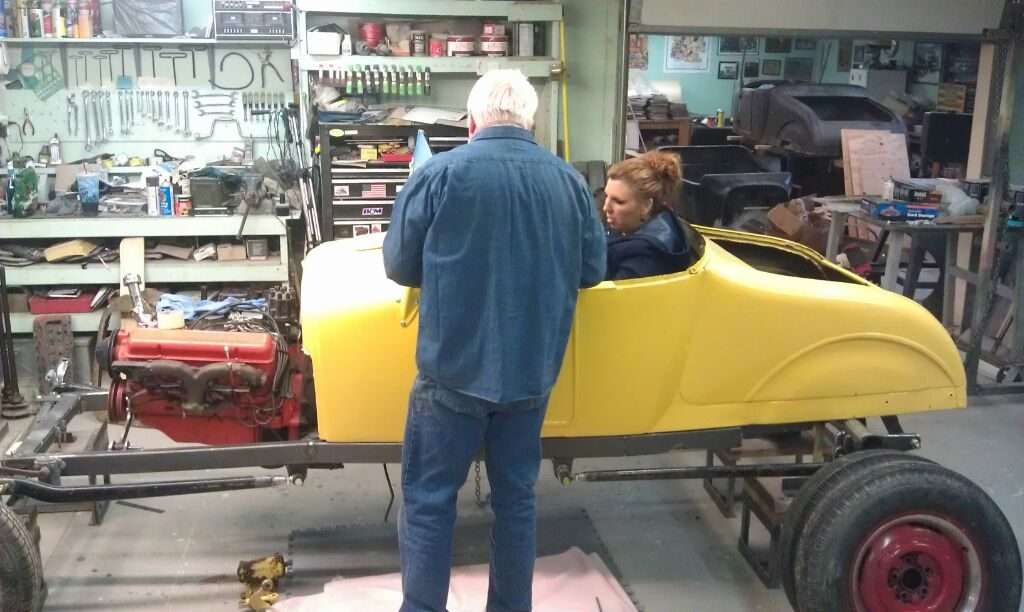 Victoria and Bob working the seating position in Victoria's '27 T roadster